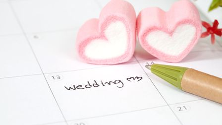 wedding plan on calendar and heart shape. Photo:Getty Images/iStockphoto
