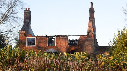 Smoke can be seen in the top of the house at The Moor at Reepham after the fire. Picture: DENISE BRA