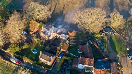 Fire crews fought flames from the early hours of the morning until 12.23pm. Picture: Phillip Leeder