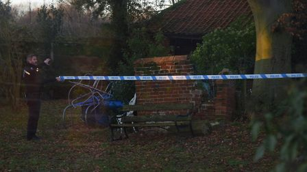Police at work at the house at The Moor at Reepham after the fire. Picture: DENISE BRADLEY