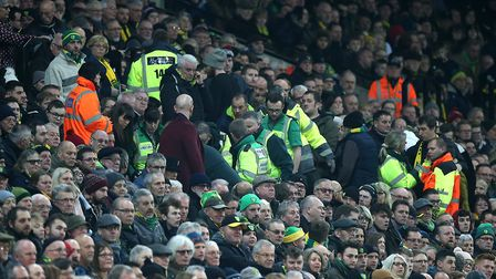 Stewards, medical staff and fellow supporters rush to Tony Kirwan's aid during the Premier League ma