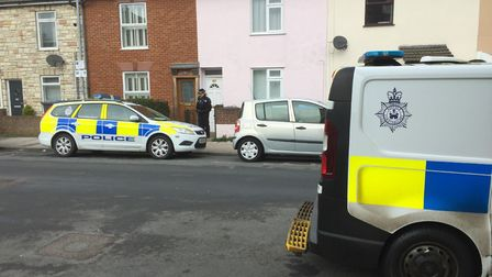 Police officers and scenes of crime officers at Tonning Street in Lowestoft after two police officer