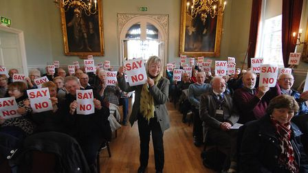 Members of the public make their feelings clear regarding the proposed Knight Hill development befor