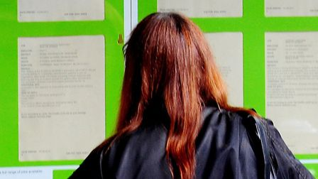 A woman looking into the window of a job centre, as a jobs fair is held in Great Yarmouth next week.