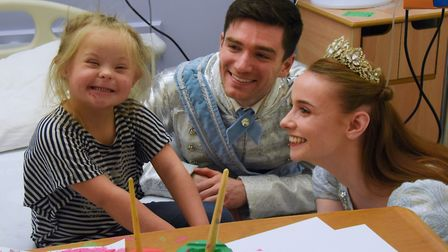 Leiya Cooper, six, from Norwich, is delighted to meet Prince Charming (David Witts) and Cinderella (