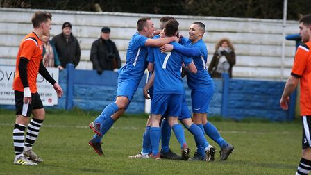 South Normanton players surround Richard Hanslow after he scored his goal.