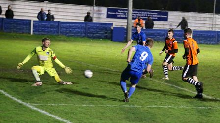 A tremendous save by Wroxham keeper Ollie Sutton keeps out Richard Hanslow.