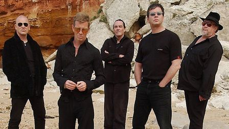 Rock Group the Stranglers on Hunstanton Beach, in front of the candy coloured cliffs, during a photo