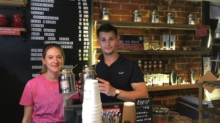 Ceara Coleman, barista at Aroma coffee shop in Norwich, with Thomas Hood, partner of Aroma coffee sh