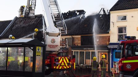 Fire fighters at the fire in Watton's High Street. Picture: DENISE BRADLEY