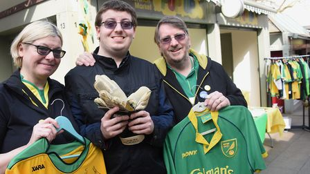 Jacob Bowles, with his mum and dad, Sharon and Andy, on his Norwich City Football Club memorabilia m