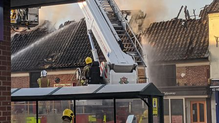 Crews from, Dereham, Thetford, Watton and Methold are tackling the fire in the roof of Beijing Diner