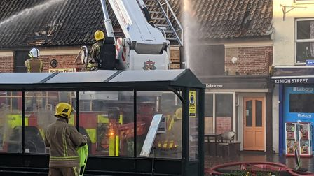 Norfolk fire said 19 fire fighters are tackling the blaze at Beijing Diner. Picture: Marc Betts