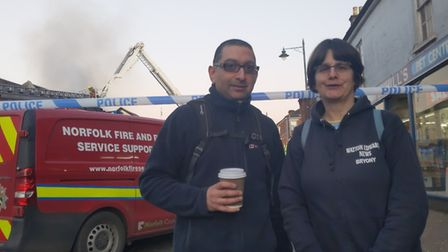 Deven Changela, 44, owner of Watton Edwards News and Post Office with staff member Bryony Horn. Pict