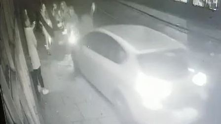 CCTV footage has captured the terrifying moment a stolen car ploughed into pub goers in Norwich befo