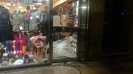 Staff and police assess the damage of a break-in to Gallyons in Norwich. Picture: Anita Barry