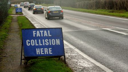 Police signs appealing for witnesses near the scene of the fatal collision involving a car and a mot