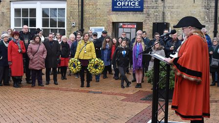 Crowds at Lowestoft rail station as mayor of Lowestoft, Alice Taylor, speaks during the Holocaust Me