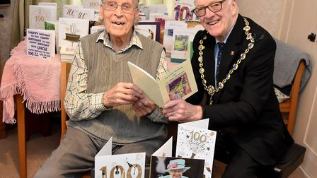 Centenarian Cyril Doy shows a book of his poetry to Mayor of Southwold Ian Bradbury. Picture: Mick H