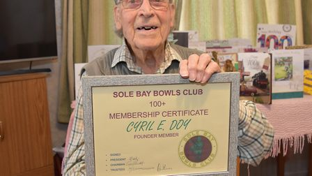 Centenarian Cyril Doy with his special certificate from Sole Bay Bowls Club. Picture: Mick Howes