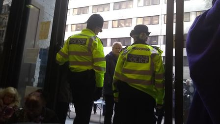 Protestors seated on the floor at Caxton House, Westminster, surrounded by police. Photo: Yvonne Cou