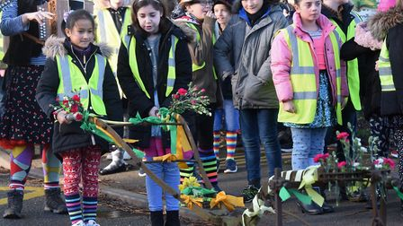 Tilney All Saints schoolchildren taking part in the revived Sharing the Plough Day, pushing a plough