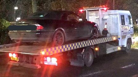 A black Saab convertible was seized by police. Picture: NSRAPT.