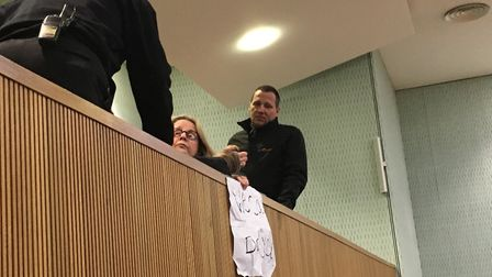 Parent Judith Taylor was asked to remove her banner by security at County Hall. Pic: Archant