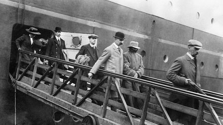 A disguised Dr Hawley Crippen arriving back in England in August 1910 led from the liner SS Meganti