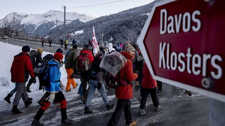 Climate protesters on a three-day protest march from Landquart to Davos. Pic: AP Photo/Michael Probs