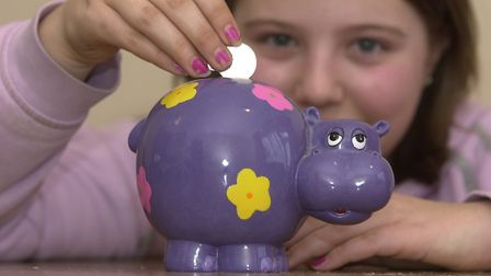 A child collecting pocket money. Picture: Archant