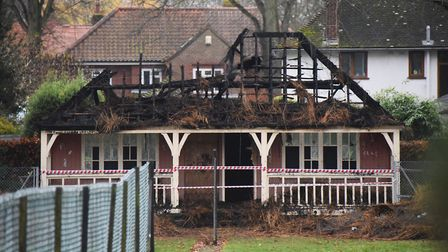 The burnt out thatched tennis pavillion at Heigham Park. Picture: DENISE BRADLEY