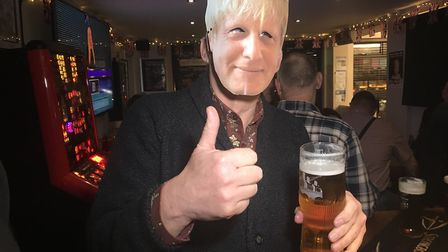 A reveller in a Boris Johnson mask enjoys the EU leaving party at The Railway Tavern in Dereham. Pic