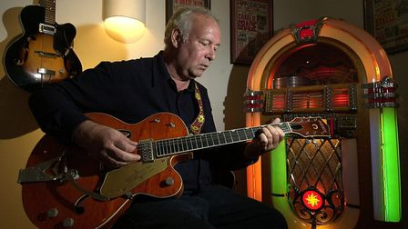 Harvey Platt founder of the Zaks burger restaurant empire - pictured with one of his guitars he play