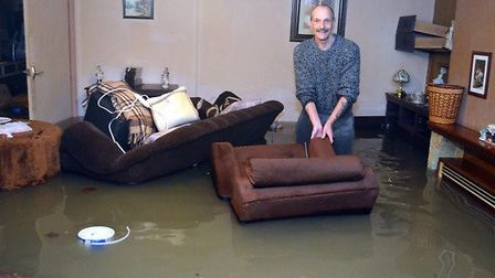 Alan Spoor in his flooded home in Marine Parade, Lowestoft on the evening of the tidal surge in Dece