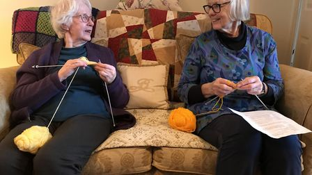 Gwyneth Archibald and Carol Erwin from Loddon WI knitting for newborn babies at the Norfolk and Norw