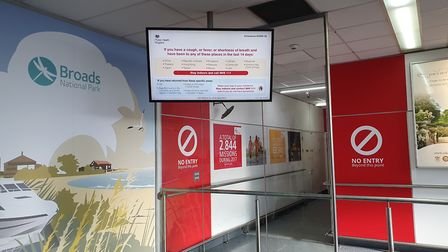 A screen at Norwich airport warns arriving passengers of the risk of Coronavirus. Picture: Archant.