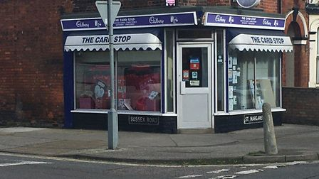 A brave shopkeeper scuffled with a would-be robber at The Card Stop convenience store on the junctio