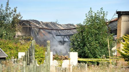 Fire-fighters damping down after a large fire at the old Pontins holiday park in Hemsby. Picture: Ja