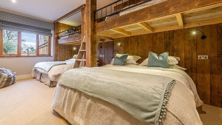 Stylish bunck beds in Red Stag Lodge, Hill Farm Massingham Luxery Barns. Iinspired by travels in Swi