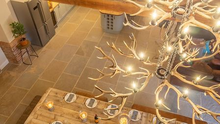 The chandelier looking over the dining table, which can seat 31 people. Picture Iceni Imaging