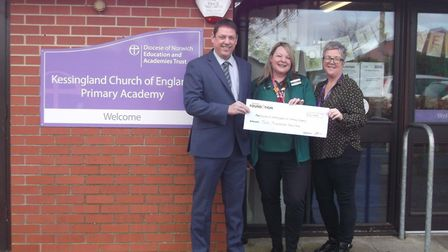 Sheryl Rumble presented headteacher Adrian Crossland with a cheque on Monday, March 2. Photo: Morris
