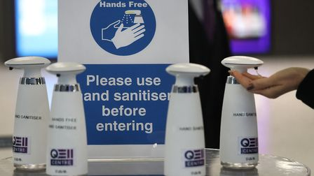 Hand sanitisers at the entrance to the QEII Centre in London. It comes as coronavirus cases in the e