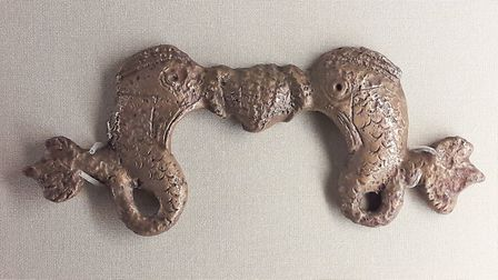 A decorative handle for an item of Roman furniture is featured on the Brampton village signin the Br