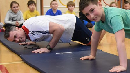 Olympic gymnast Kristian Thomas encourages the children at Little Snoring Primary Academy in their s