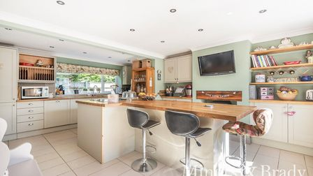 Loke Cottage, on the edge of Filby Broad, is on the market at a guide price of £650,000-£675,000. Pi
