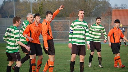 Daniel Tuddenham and Charlie Garcia pictured in action for North Elmham & Lyng Reserves on Saturday.