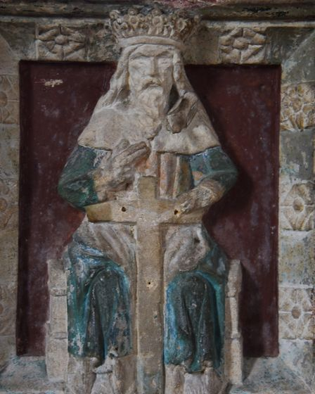 The figure of God on the baptismal font at Acle St Edmunds Church. Picture: DENISE BRADLEY