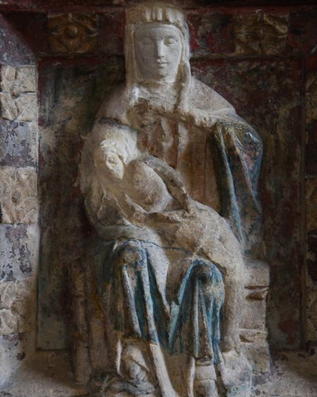 The figure of Mary holding Christ's body on the baptismal font at Acle St Edmunds Church. Picture: D