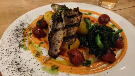 Food at The Hunworth Bell in north Norfolk. Pictured is chargrilled seabass fillets, chorizo, saffro